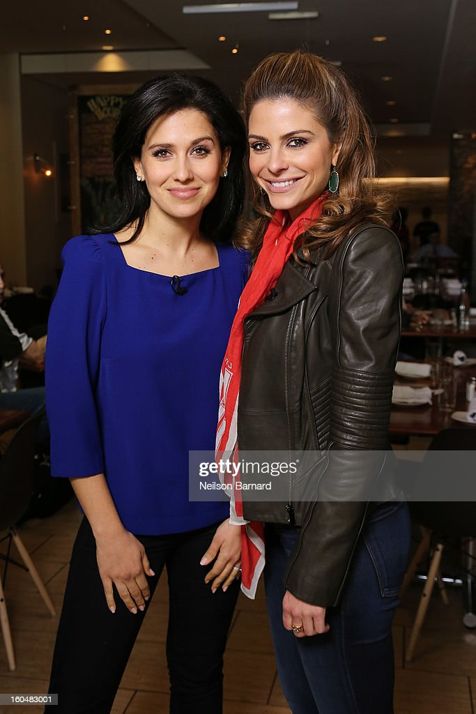 Host Maria Menounos and guest Hilaria Baldwin tape a segment for 'Extra' in Jackson Square on February 1, 2013 in New Orleans, Louisiana.