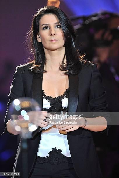 Host Marie Drucker looks on during Les Victoires de La Musique 2011 Show at Palais des Congres on March 1 2011 in Paris France