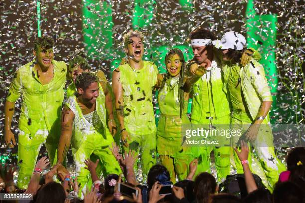 Host Mario Bautista and Caeli get slimed on stage during the Nickelodeon Kids' Choice Awards Mexico 2017 at Auditorio Nacional on August 19 2017 in...