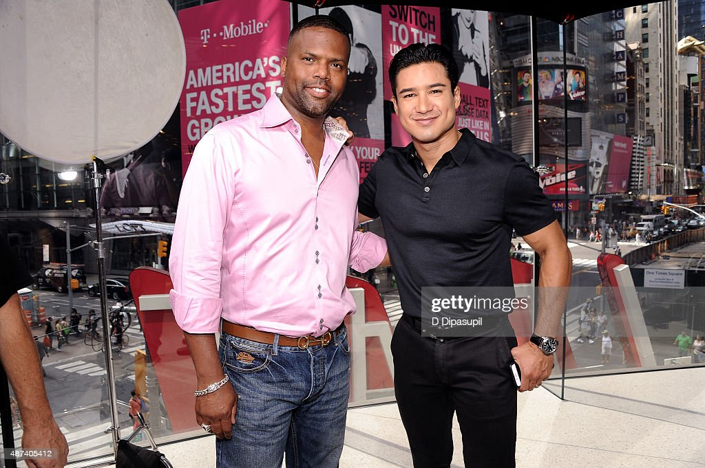 Host Mario Lopez (R) and correspondent AJ Calloway on the set of 'Extra' at their New York studios at H&M in Times Square on September 9, 2015 in New York City.