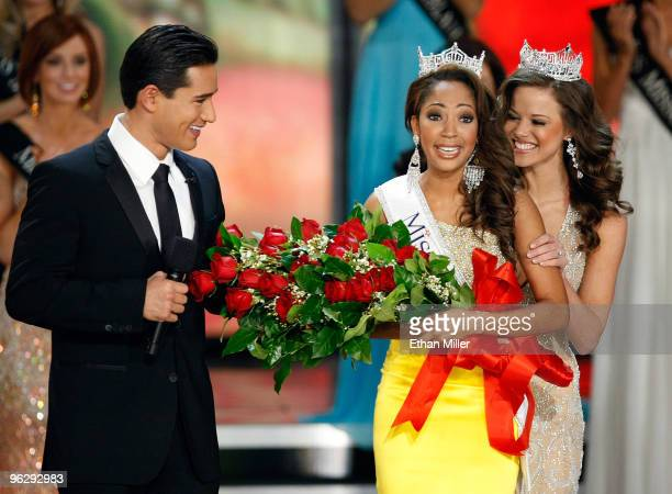 Host Mario Lopez looks on as Miss America 2009 Katie Stam hugs Caressa Cameron Miss Virginia after crowning her the new Miss America during the 2010...