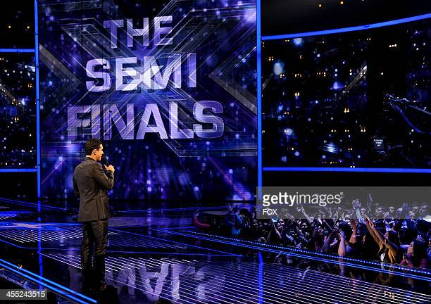 Host Mario Lopez onstage on FOX's 'The X Factor' Season 3 Top 4 Live Performance Show on December 11 2013 in Hollywood California
