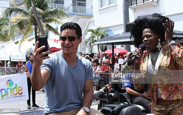 TV host Mario Lopez poses for a selfie while he serves as Grand Marshal for the 7th annual Miami Beach Gay Pride Parade on April 12 2015 in in Miami...