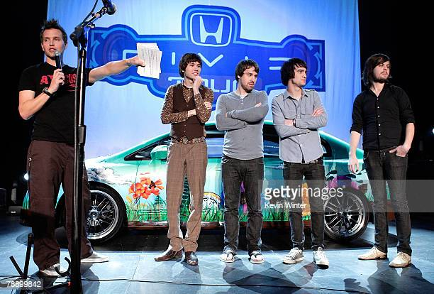 Host Mark Hoppus from the band 44 and members of the band Panic at the Disco frontman Brendon Urie guitarist Ryan Ross bassist Jon Walker and drummer...