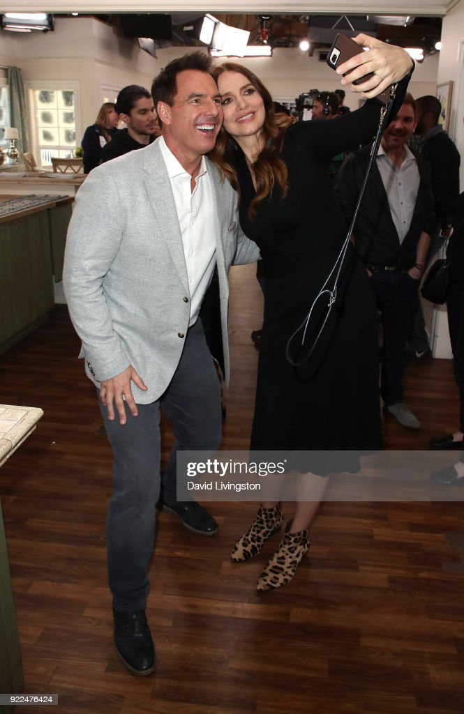 Host Mark Steines (L) and actress Saffron Burrows pose for a selfie at Hallmark's 'Home & Family' at Universal Studios Hollywood on February 21, 2018 in Universal City, California.