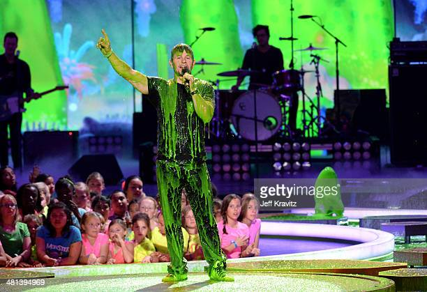 Host Mark Wahlberg gets slimed onstage at Nickelodeon's 27th Annual Kids' Choice Awards at USC Galen Center on March 29 2014 in Los Angeles California