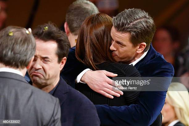 TV host Markus Lanz and his wife Angela Gessmann are seen after the last broadcast of the Wetten dass tv show on December 13 2014 in Nuremberg Germany
