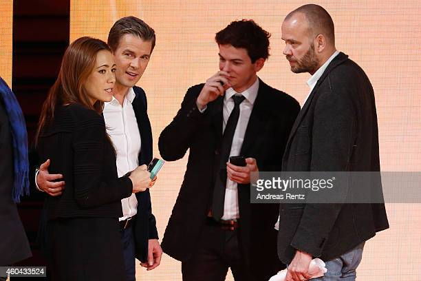 TV host Markus Lanz and his wife Angela Gessmann speak to crew members after the last broadcast of the Wetten dass tv show on December 13 2014 in...