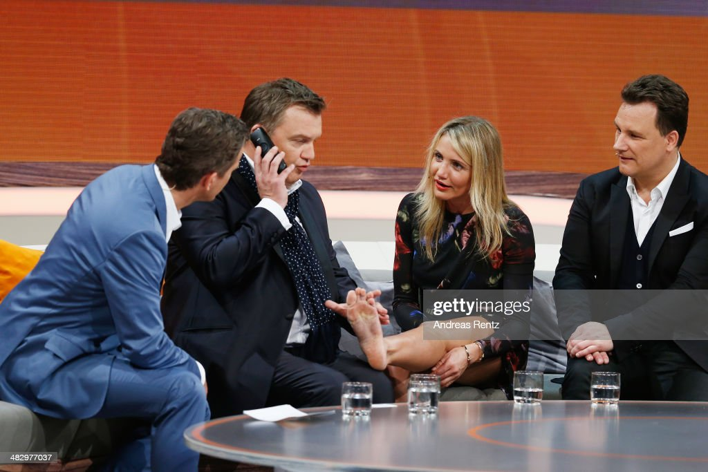 TV host Markus Lanz, Hape Kerkeling, Cameron Diaz and Guido Maria Kretschmer talk on stage during the 'Wetten, dass..?' tv show on April 5, 2014 in Offenburg, Germany.