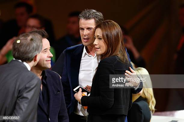 TV host Markus Lanz his wife Angela Gessmann are seen after the last broadcast of the Wetten dass tv show on December 13 2014 in Nuremberg Germany