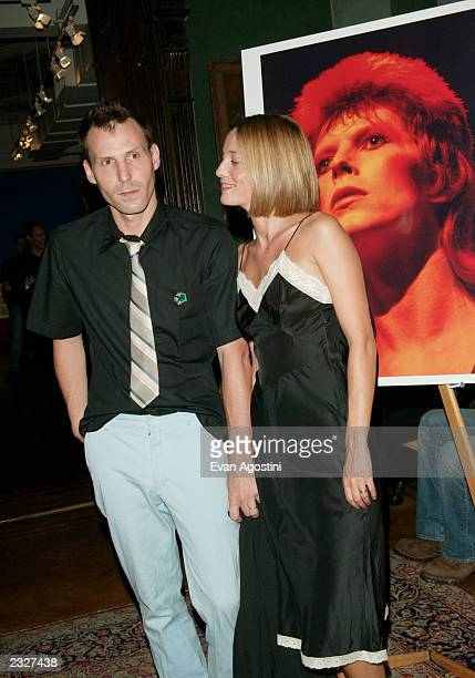 Host Marlon Richards with wife Lucie De La Falaise at the 'MOONAGE DAYDREAM The Life and Times of Ziggy Stardust' book party at The National Arts...