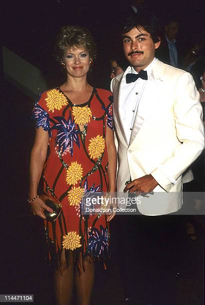Host Mary Hart and Mohamed Khashoggi pose for a portrait in 1986 in Los Angeles California