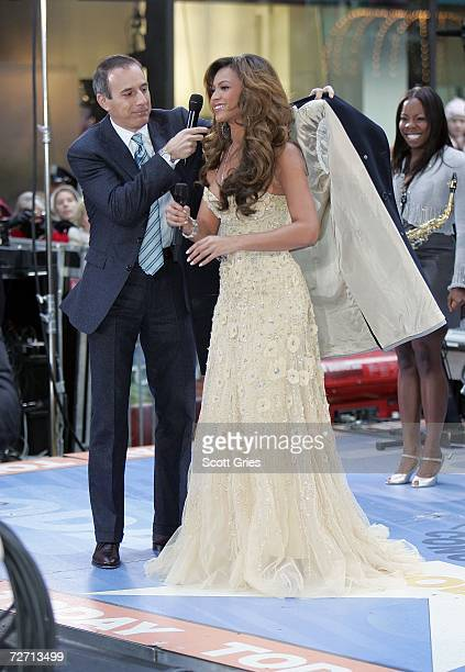 Host Matt Lauer covers up singer/actress Beyonce Knowles following her performance on NBC's Today Show in Rockefeller Center on December 4 2006 in...