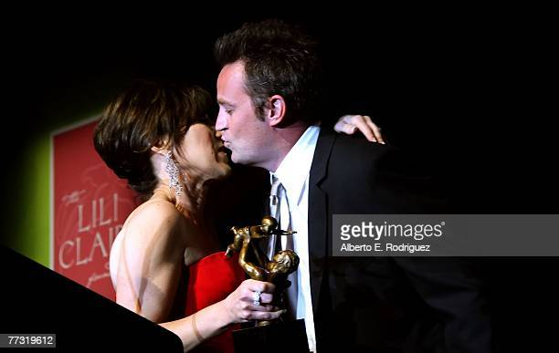 Host Matthew Perry and Lili Claire founder Leslie LittResnick kiss during the Lili Claire Foundation 10th annual benefit dinner and auction held at...