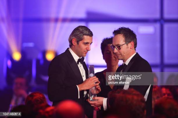 Host Matthias Opdenhoevel presents Michel Abdollahi with the award for best personal performance at the German Television Award ceremony in...
