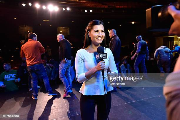 UFC host Megan Olivi conducts an interview during the UFC 189 World Championship Press Tour press conference inside The Strand Theatre on March 25...