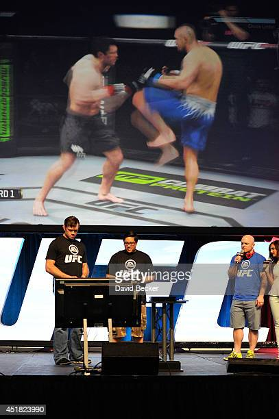 UFC host Megan Olivi hosts the EA Sports UFC presentation as former mixed martial artist Forrest Griffin plays the new UFC EA Sports game with a fan...
