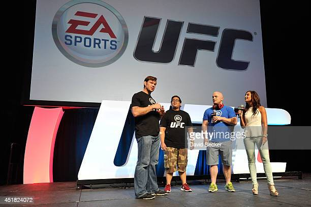 UFC host Megan Olivi hosts the EA Sports UFC presentation as former mixed martial artist Forrest Griffin interacts with fans during the UFC Fan Expo...