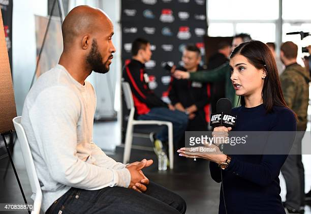 UFC host Megan Olivi interacts with UFC Flyweight Champion Demetrious 'Mighty Mouse' Johnson during the UFC 186 Ultimate Media Day at Scena on April...
