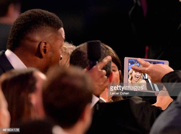 Host Michael Strahan actress Reese Witherspoon and agent Jim Toth attend the 20th annual Critics' Choice Movie Awards at the Hollywood Palladium on...