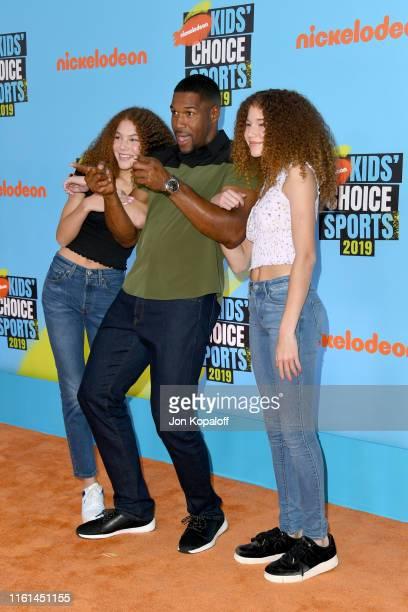 Host Michael Strahan with Sophia Strahan and Isabella Strahan attend Nickelodeon Kids' Choice Sports 2019 at Barker Hangar on July 11 2019 in Santa...