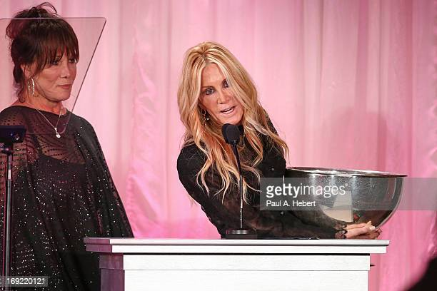 Host Michele Lee and actress Joan Van Ark on stage during the 2013 Icon Awards Gala at Beverly Hills Hotel on May 21 2013 in Beverly Hills California
