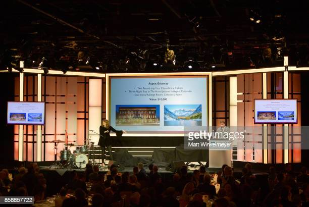 Host Michelle Collins and auctioneer Gabriel Butu speaks onstage at Point Honors Los Angeles 2017 benefiting Point Foundation at The Beverly Hilton...