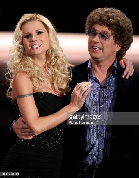 TV host Michelle Hunziker and German comedian Atze Schroeder attend the 191st 'Wetten dass ' show at TUI Arena on November 06 2010 in Hanover Germany