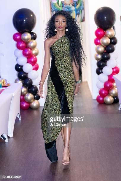 Host Midori Amae walks the runway during the GY6 Showcase at FTM Fashion Week Season 9 at the Jacksonville Onslow Council for the Arts on October 23,...