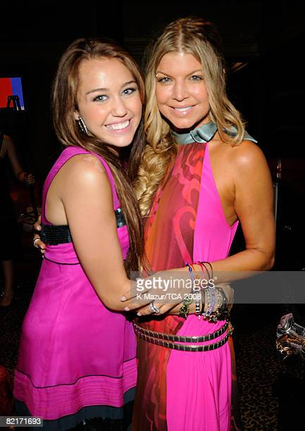 LOS ANGELES CA AUGUST 03 Host Miley Cyrus and Fergie during the 2008 Teen Choice Awards at Gibson Amphitheater on August 3 2008 in Los Angeles...