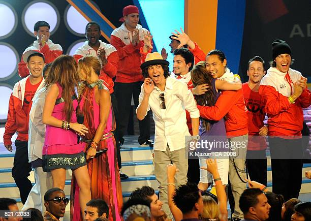 Host Miley Cyrus singer Fergie Adam Sevani Mandy Jiroux and director John M Chu onstage during the 2008 Teen Choice Awards at Gibson Amphitheater on...