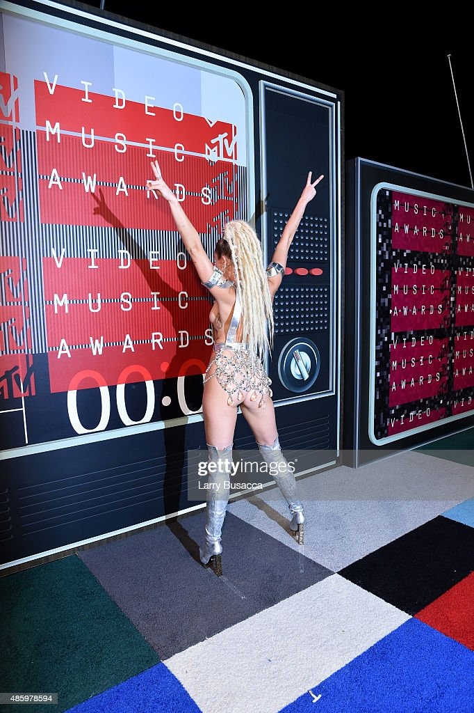 Host Miley Cyrus, styled by Simone Harouche, attends the 2015 MTV Video Music Awards at Microsoft Theater on August 30, 2015 in Los Angeles, California.