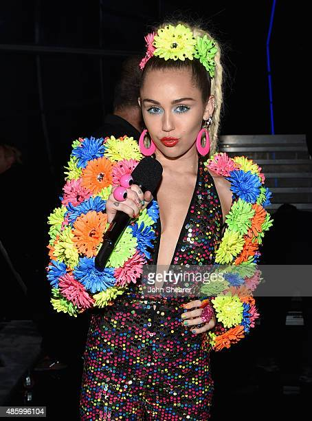 Host Miley Cyrus styled by Simone Harouche poses backstage during the 2015 MTV Video Music Awards at Microsoft Theater on August 30 2015 in Los...
