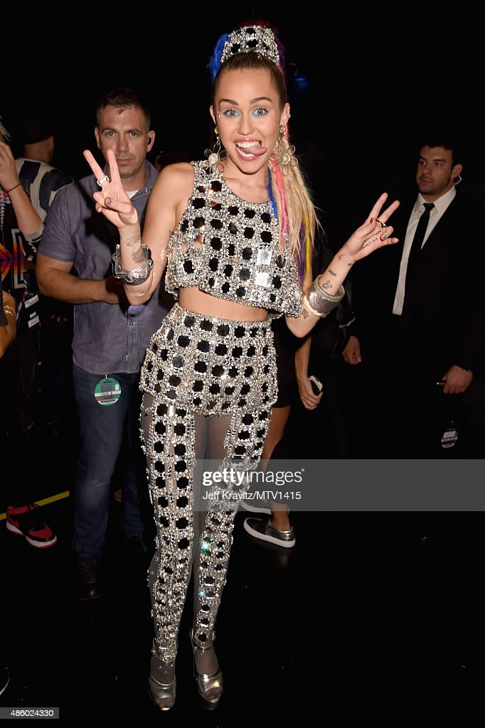 Host Miley Cyrus, styled by Simone Harouche, poses backstage during the 2015 MTV Video Music Awards at Microsoft Theater on August 30, 2015 in Los Angeles, California.