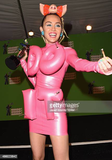 Host Miley Cyrus styled by Simone Harouche poses in the press room at the 2015 MTV Video Music Awards at Microsoft Theater on August 30 2015 in Los...