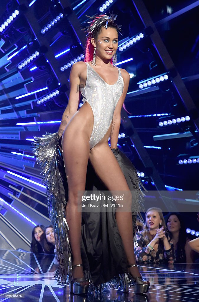 Host Miley Cyrus, styled by Simone Harouche, poses onstage during the 2015 MTV Video Music Awards at Microsoft Theater on August 30, 2015 in Los Angeles, California.