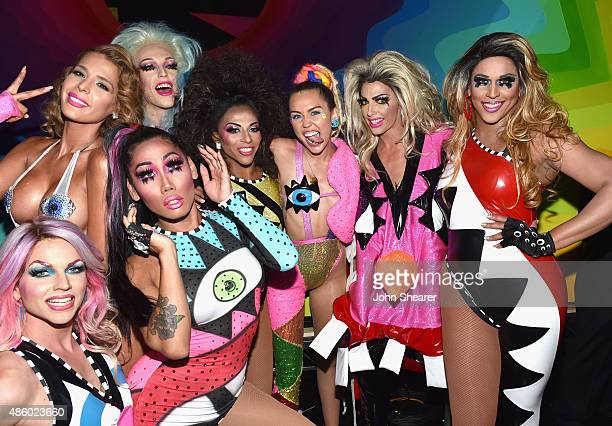 Host Miley Cyrus styled by Simone Harouche poses with dancers backstage during the 2015 MTV Video Music Awards at Microsoft Theater on August 30 2015...