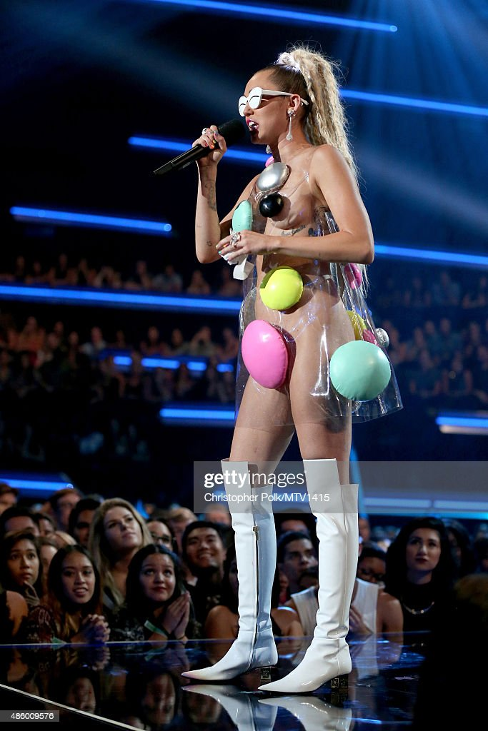 Host Miley Cyrus, styled by Simone Harouche, speaks onstage during the 2015 MTV Video Music Awards at Microsoft Theater on August 30, 2015 in Los Angeles, California.
