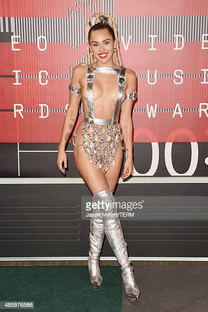 Host Miley Cyrus, styled by Simone Harouche, wearing a custom Versace outfit and boots, attends the 2015 MTV Video Music Awards at Microsoft Theater...