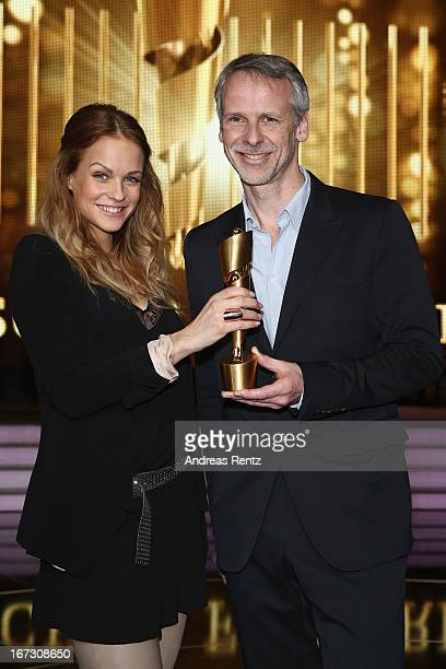 TV host Mirjam Weichselbraun and Fred Kogel pose with the Lola German Film Award during a photo call at FriedrichstadtPalast on April 24 2013 in...