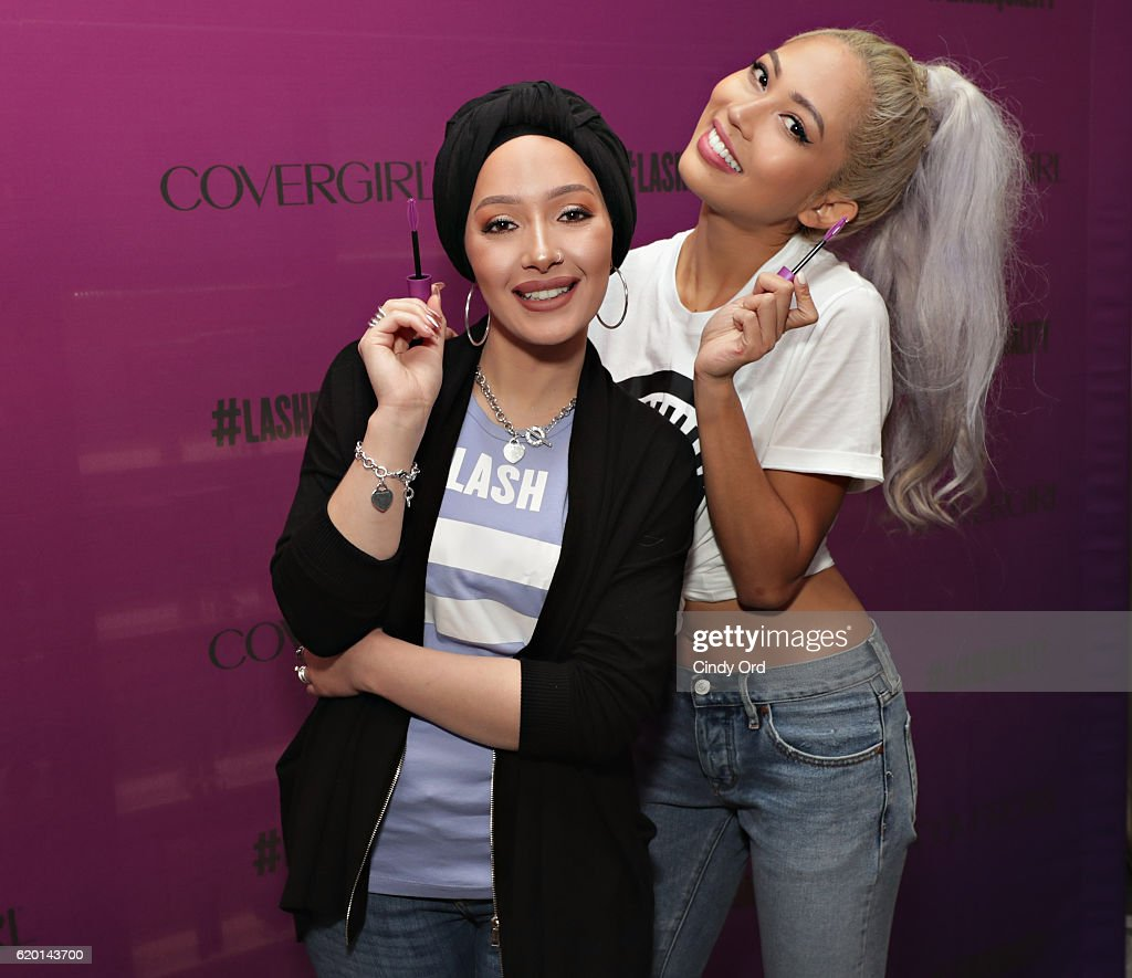 DJ, host, model and actress Amy Pham (R) and beauty blogger Nura Afia (L) offer a sneak peek at the new COVERGIRL So Lashy mascara and commercial that promotes #LashEquality on November 1, 2016 in New York City.