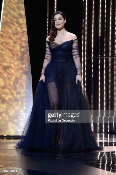 Host Monica Bellucci arrives on stage during the Opening Ceremony of the 70th annual Cannes Film Festival at Palais des Festivals on May 17, 2017 in...