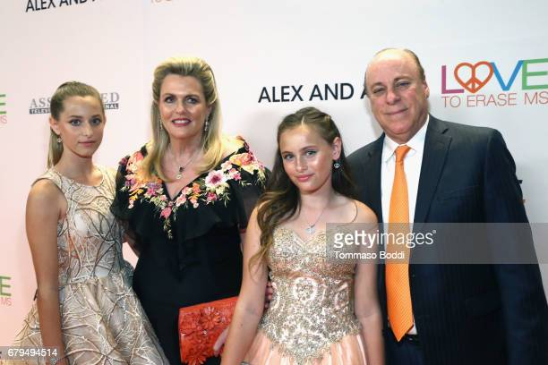 Host Nancy Davis with Isabella Rickel Mariella Rickel and Ken Rickel attend the 24th Annual Race To Erase MS Gala at The Beverly Hilton Hotel on May...