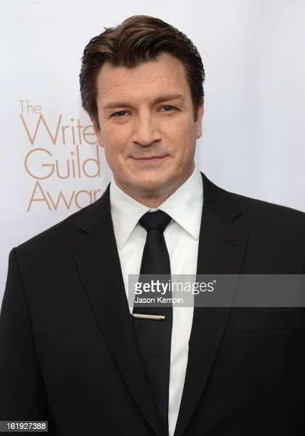 Host Nathan Fillion arrives at the 2013 WGAw Writers Guild Awards at JW Marriott Los Angeles at LA LIVE on February 17 2013 in Los Angeles California