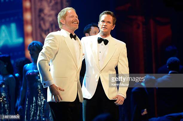Host Neil Patrick Harris and Jesse Tyler Ferguson perform onstage at the 66th Annual Tony Awards at The Beacon Theatre on June 10 2012 in New York...