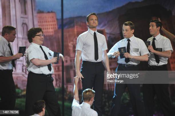 Host Neil Patrick Harris performs with the cast of 'Book of Mormon' onstage at the 66th Annual Tony Awards at The Beacon Theatre on June 10 2012 in...