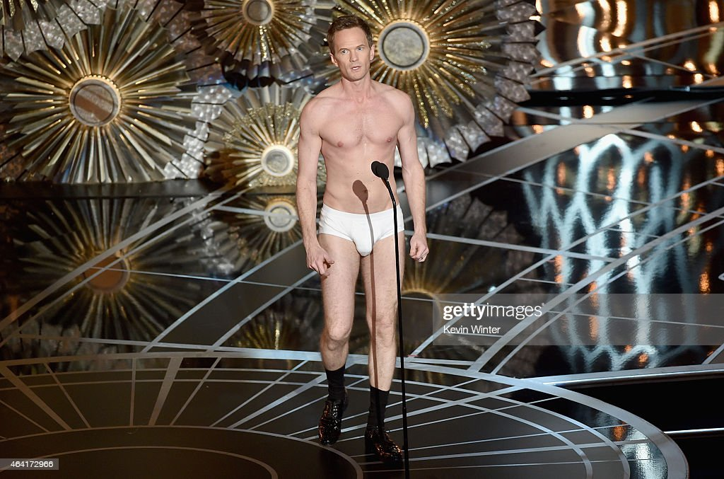 Host Neil Patrick Harris stands unclothed onstage during the 87th Annual Academy Awards at Dolby Theatre on February 22, 2015 in Hollywood, California.