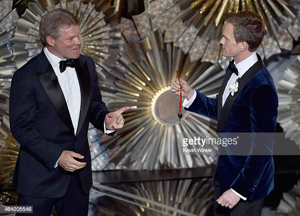Host Neil Patrick Harris with PricewaterhouseCoopers representative Brian Cullinan onstage during the 87th Annual Academy Awards at Dolby Theatre on...