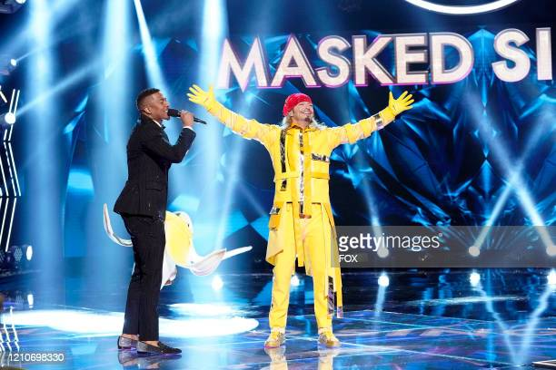 Host Nick Cannon and Bret Michaels in the The Mother Of All Final Face Offs Part 2 episode of THE MASKED SINGER airing Wednesday April 22 on FOX
