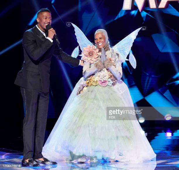 Host Nick Cannon and Dionne Warwick in the MaskMatics Group B Playoffs episode of THE MASKED SINGER airing Wednesday Feb 26 on FOX